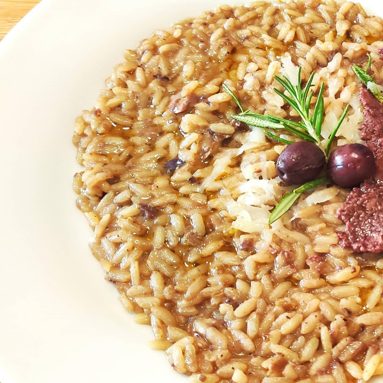 Risotto con patè di olive nere